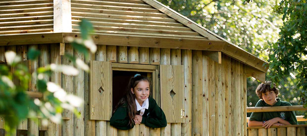 pupil inside learning tree hut